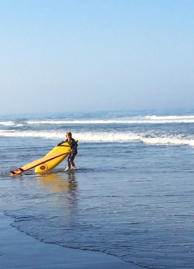 boy with two surfboards