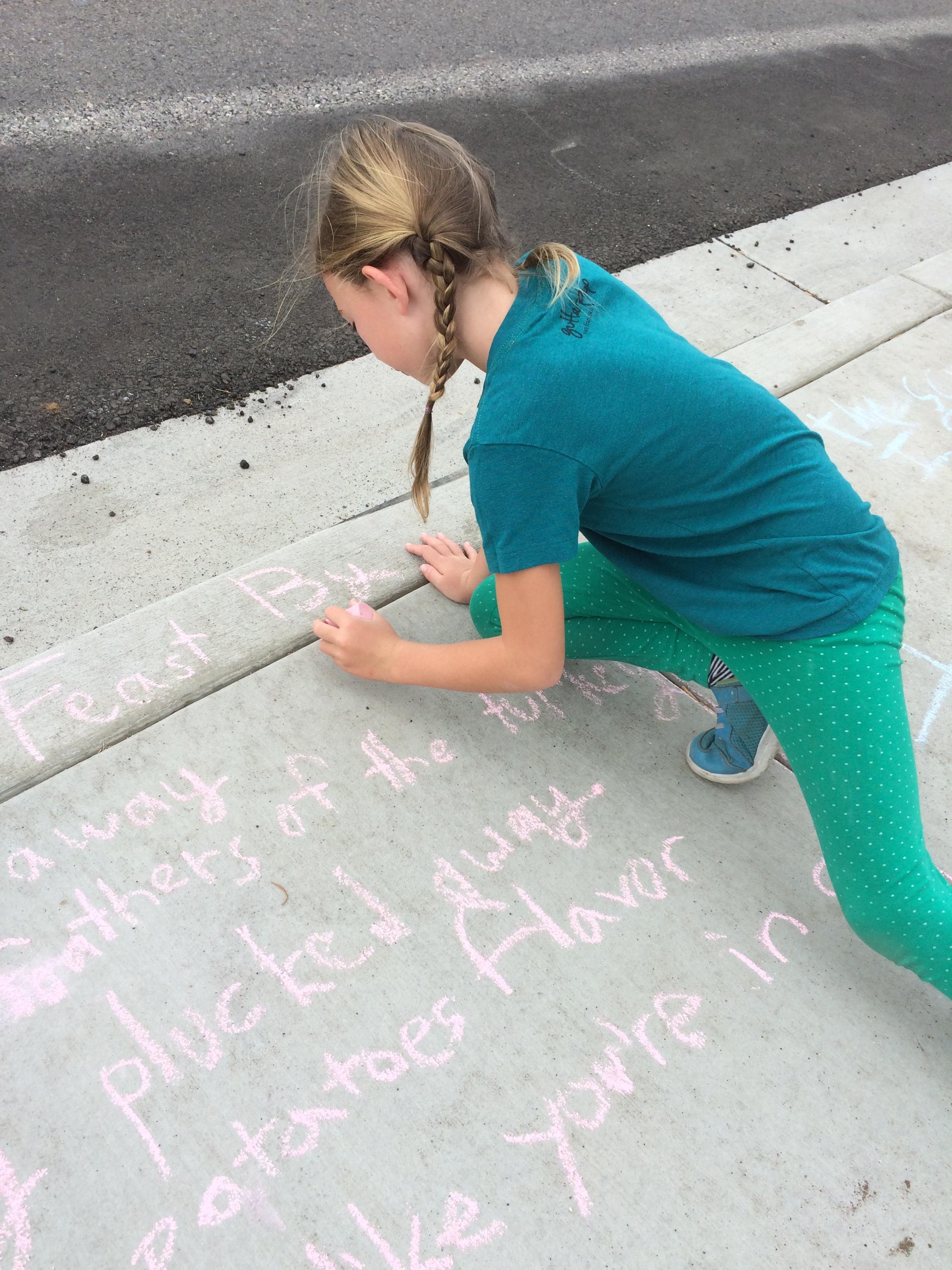 chalking the sidewalk