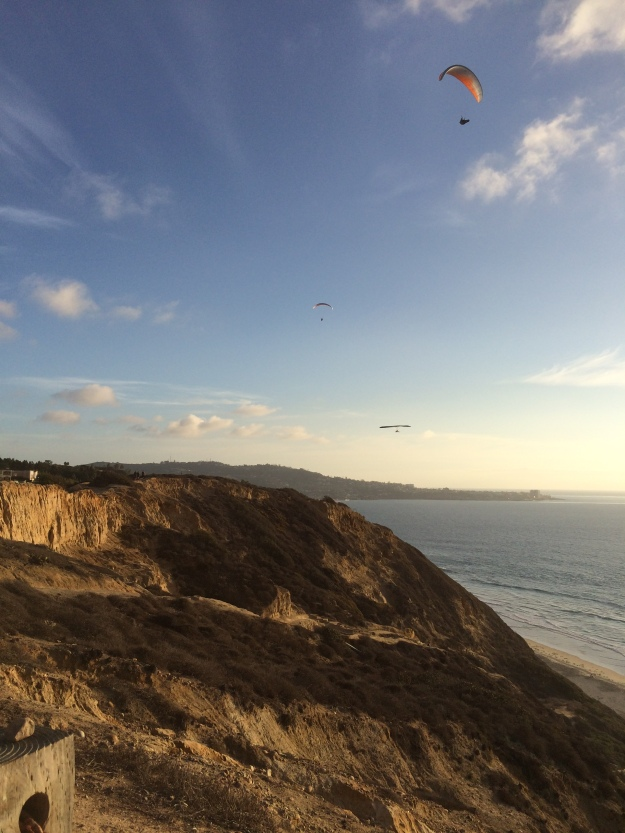 three gliders off the cliffs