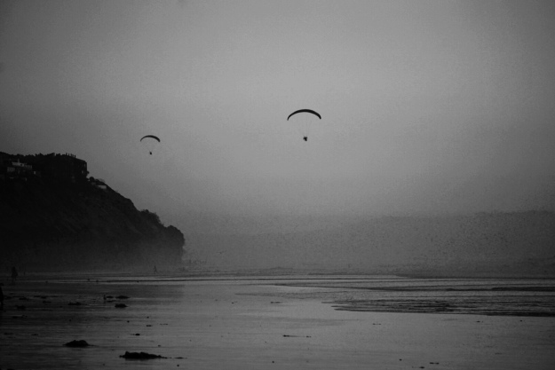 hang gliders in the fog